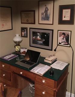 [The dark green desk]